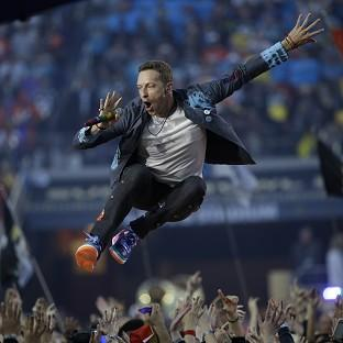 Coldplay climb towards number one on album charts after Super Bowl show
